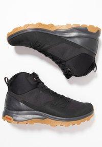 Salomon - OUTSNAP CSWP - Zimní obuv - black/ebony - 1