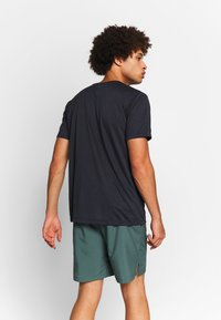 Salomon - AGILE GRAPHIC TEE  - Camiseta estampada - black/heather