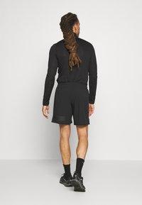 Salomon - SENSE - Pantalón corto de deporte - black - 2