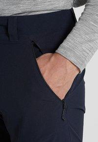 Salomon - WAYFARER TAPERED PANT - Outdoorové kalhoty - night sky - 3
