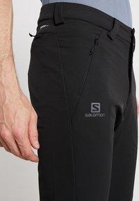 Salomon - WAYFARER WARM STRAIGHT PANT  - Pantaloni - black - 3