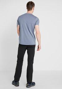 Salomon - WAYFARER WARM STRAIGHT PANT  - Pantaloni - black - 2