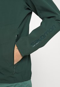 Salomon - OUTLINE - Hardshell jacket - green gables/lemon curry - 6