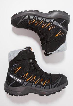 XA PRO 3D WINTER TS CSWP - Winter boots - black/magnet/tangelo