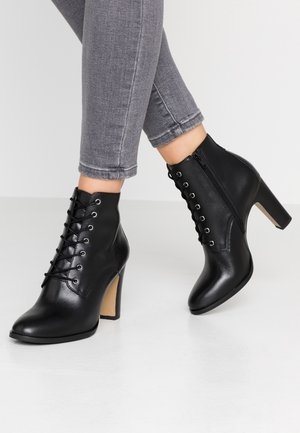 EDIM - High Heel Stiefelette - noir