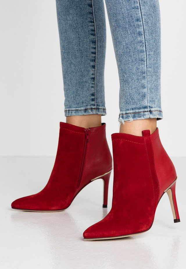 ALEPAL - High heeled ankle boots - red