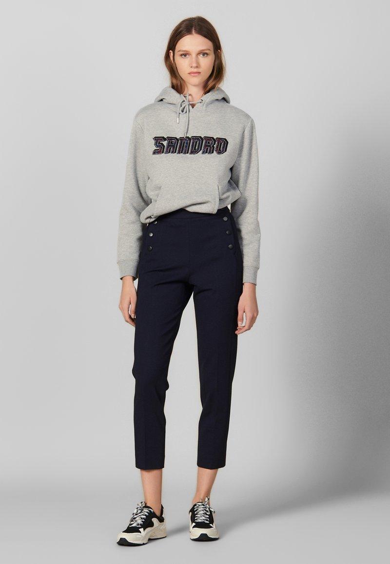 sandro - BRIDGE - Trousers - black