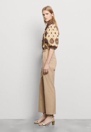 FEYNE - Trousers - beige