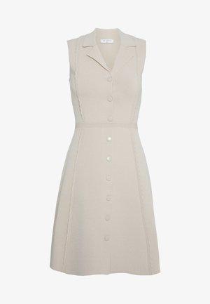 Stickad klänning - beige