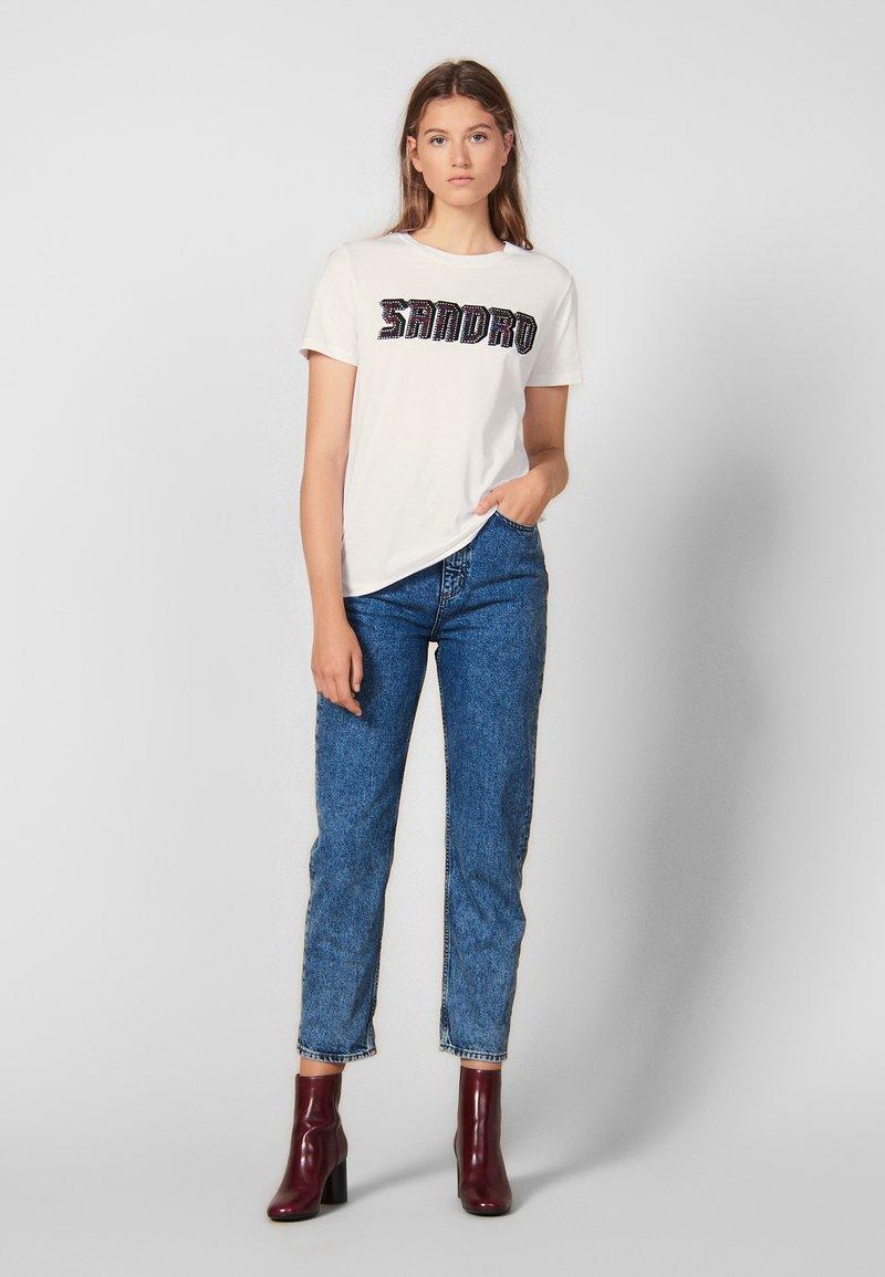 sandro - CHELLA - T-shirts print - white