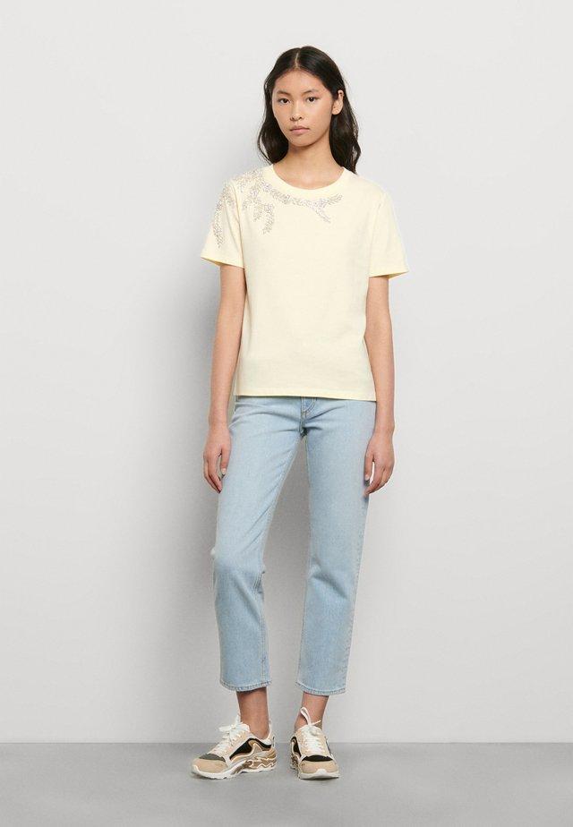 T-shirts print - jaune