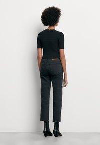 sandro - CECIL - T-shirt imprimé - noir - 2