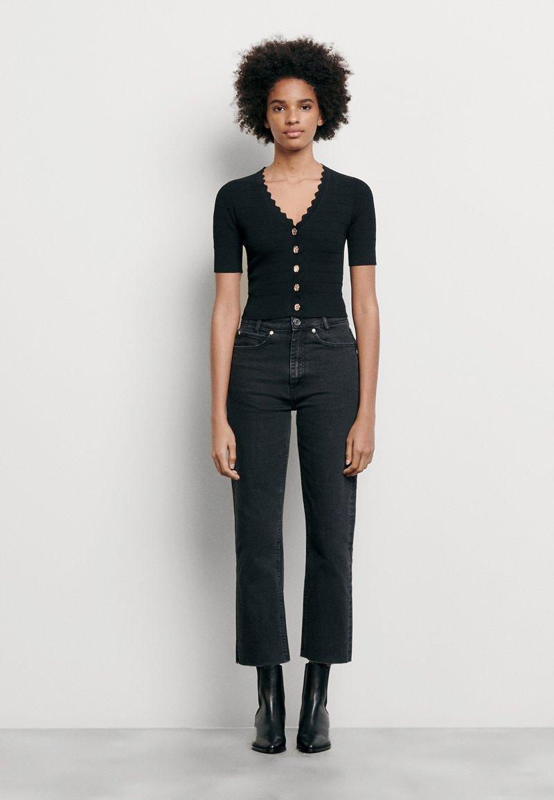 sandro - CECIL - T-shirt imprimé - noir