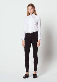 sandro - Jeans Skinny Fit - black - 0