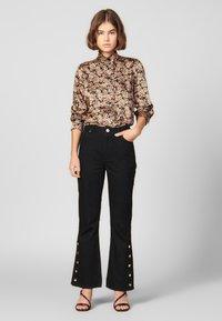 sandro - SNAPY - Jeans straight leg - black - 0