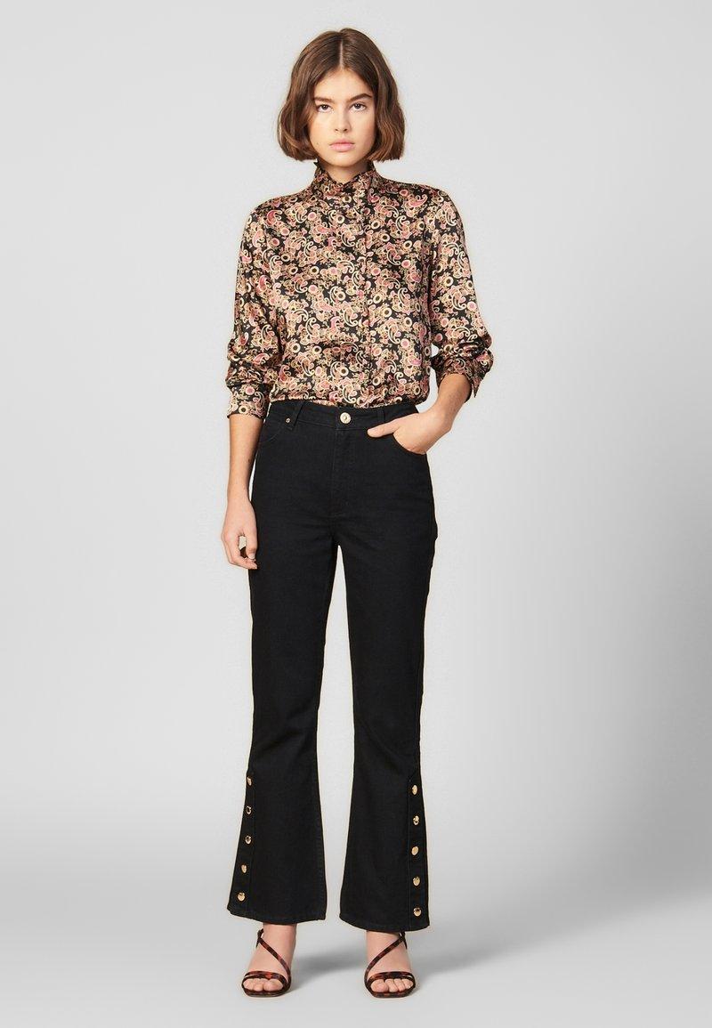 sandro - SNAPY - Jeans straight leg - black