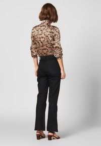 sandro - SNAPY - Jeans straight leg - black - 2