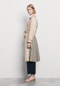 sandro - VICTORY - Trenchcoat - beige - 1