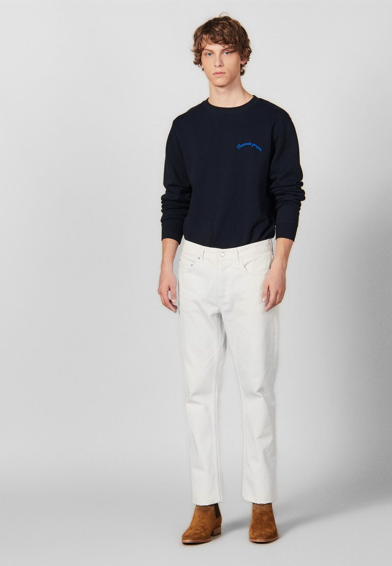 sandro - Slim fit jeans - white