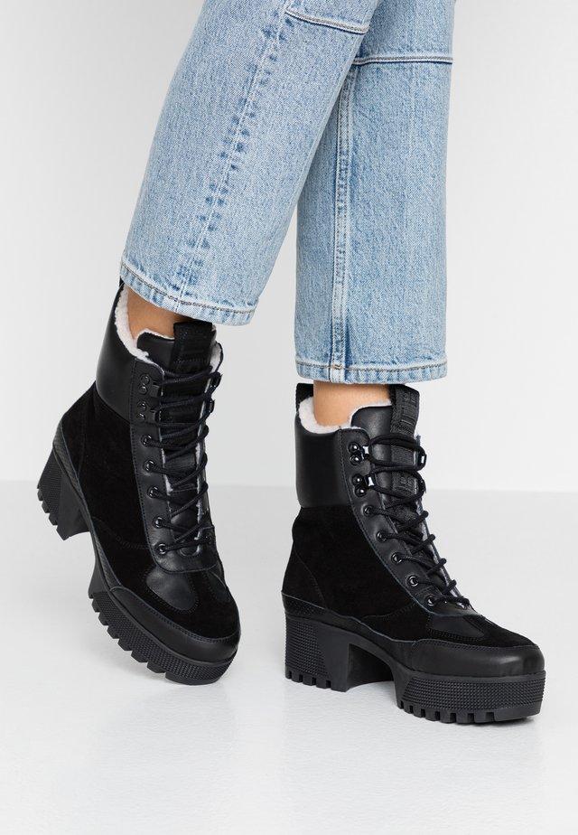 CELESTE HIKE - Platform ankle boots - black