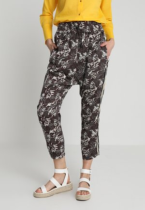 PRINTED PANTS WITH STRIPED SIDE TAPE - Trousers - dark brown/white/multi-coloured