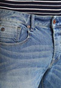 Scotch & Soda - Slim fit jeans - blue denim - 3
