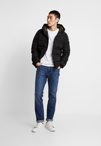 Scotch & Soda - CLASSIC HOODED PRIMALOFT JACKET - Vinterjacka - black - 1