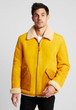 SEASONAL SHORT SHEARLING JACKET - Leather jacket - sunflower yellow
