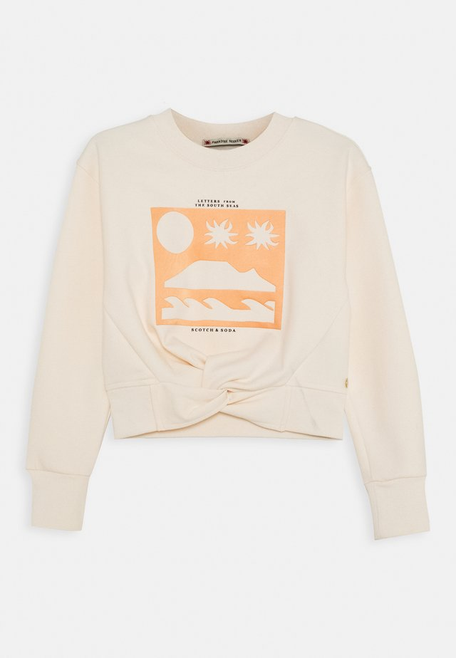 CROPPED WITH KNOT DETAIL AND THEME ARTWORKS - Sweatshirt - light apricot