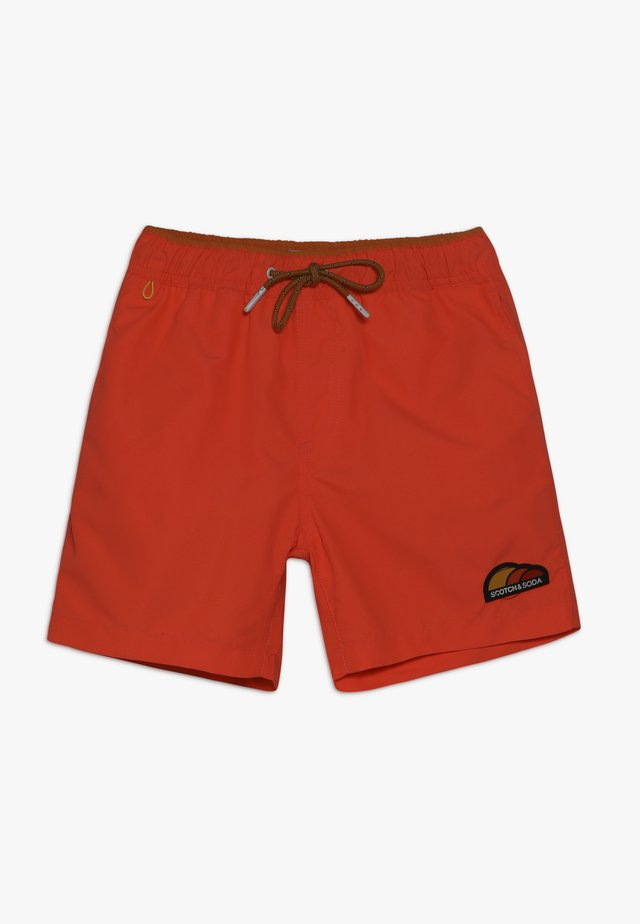 MAGIC PRINT - Swimming shorts - orange