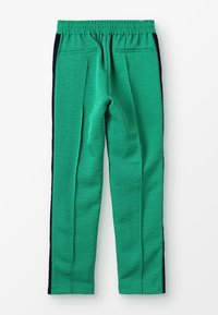 Scotch & Soda - DRAPEY PANTS WITH SIDE TAPES - Tracksuit bottoms - paradise green - 1