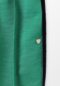 Scotch & Soda - DRAPEY PANTS WITH SIDE TAPES - Tracksuit bottoms - paradise green - 4