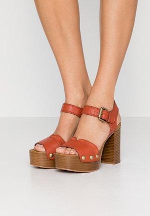 High heeled sandals - rust