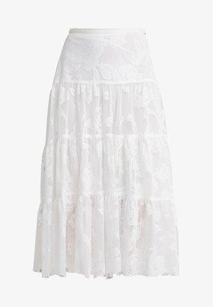 Áčková sukně - iconic milk