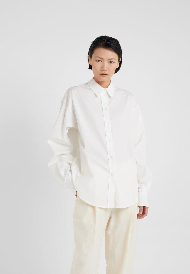 Skjorta - white powder