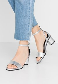 Selected Femme - SLFMERLENE METALLIC - Sandals - silver - 0
