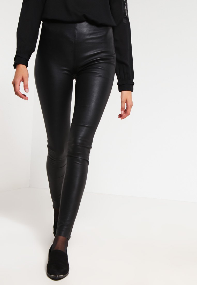 Selected Femme - SFSYLVIA - Leather trousers - black