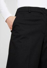 Selected Femme - SLFEMILO CROPPED PANT - Kalhoty - black - 5