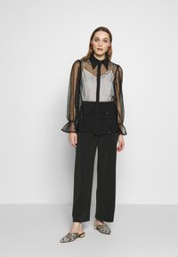 Selected Femme - SLFTUIJA TEA WIDE PANTS - Trousers - black - 1