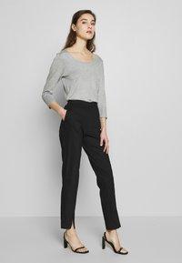 Selected Femme - SLFABBY SLIT PANT - Pantalones - black - 1