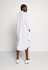 Selected Femme - SLFAMARIS LONG SHIRT DRESS - Shirt dress - snow white/black - 2