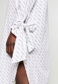 Selected Femme - SLFAMARIS LONG SHIRT DRESS - Shirt dress - snow white/black - 3