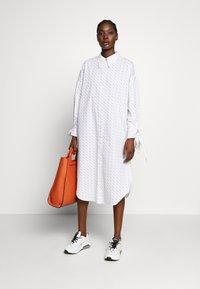 Selected Femme - SLFAMARIS LONG SHIRT DRESS - Shirt dress - snow white/black - 1