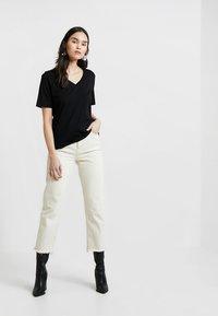 Selected Femme - SLFSTANDARD V-NECK TEE - Jednoduché triko - black - 1
