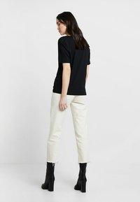 Selected Femme - SLFSTANDARD V-NECK TEE - Jednoduché triko - black - 2