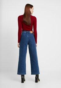 Selected Femme - SLFSUSAN WIDE BELLE - Flared jeans - dark blue denim - 2