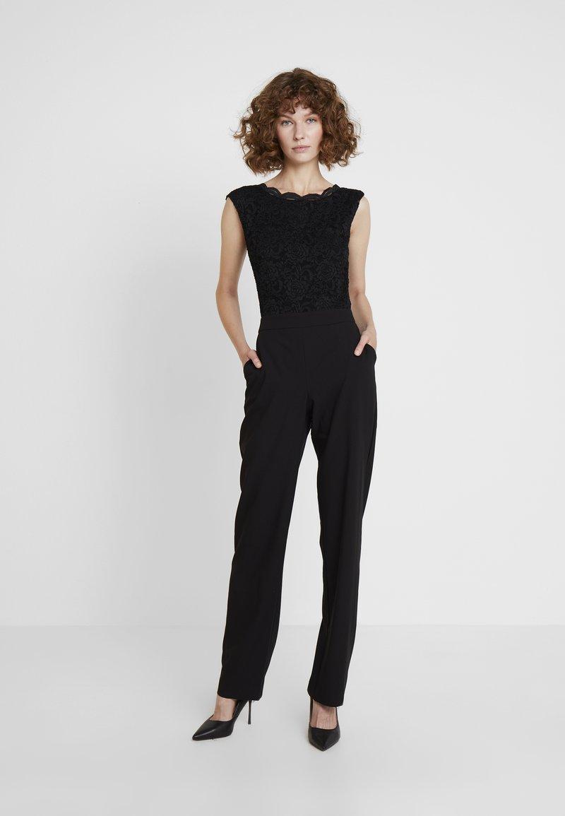 Swing - Jumpsuit - schwarz