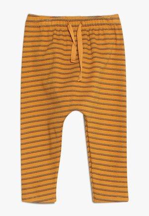HAILEY PANTS - Leggings - inca gold