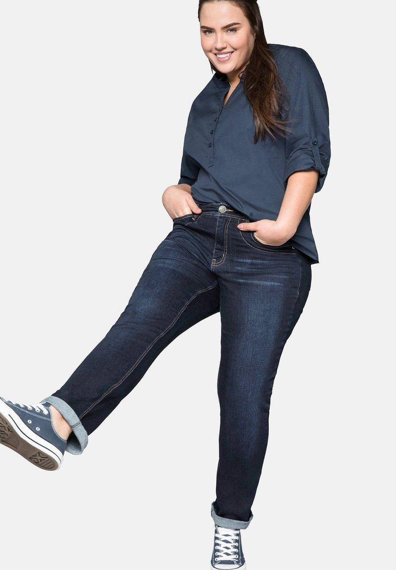 Sheego - Slim fit jeans - dark blue denim
