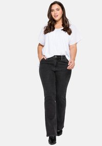 Sheego - Jeans bootcut - black denim - 1